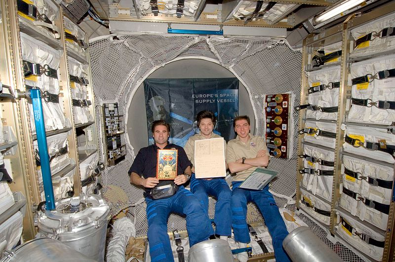Crew in ATV with Jules Verne manuscript.jpg