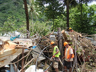 2009 Samoa earthquake and tsunami - Crews working near the damage from the tsunami in American Samoa