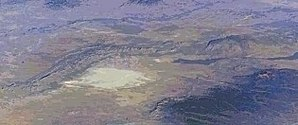 Tularosa Basin - NASA: Aerial view the Jornada del Muerto Desert region, with dry lake, of the Tularosa Basin.