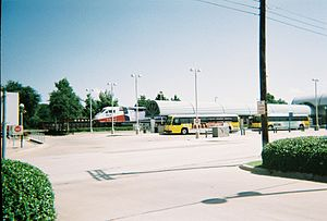 Downtown Irving/Heritage Crossing station - DART Buses and TRE Train awaiting departures from South Irving station (2007).