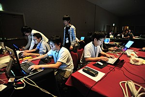 A team competing in the CTF competition at DEF...