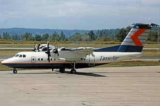 Time Air - Time Air DHC-7 Dash 7 arriving at Seattle-Tacoma Airport in 1989