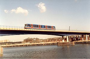 Docklands Light Railway - A first generation DLR EMU crosses West India Dock, September 1987.