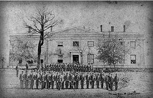 Dahlonega Mint - Students at North Georgia College practice military drill in front of the former Dahlonega Mint in 1877 or 1878. The college used the building from 1873 until it burned down in 1878.