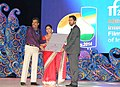 Damodar Naik and Actress Divya Dutta presenting the Special Jury award to Shrihari Sathe Director of the Indian film 'Ek Hazarachi Note', at the closing ceremony of the 45th International Film Festival of India (IFFI-2014).jpg