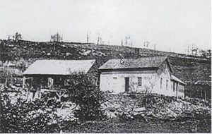 "Daniel Shays - Daniel and Abigail Shays' Pelham, MA farmhouse, circa 1898. This ""Cape style"" home was typical amongst local farmers at the time. The house was destroyed and the surrounding lands flooded during the creation of the Quabbin Reservoir in the 1930s."