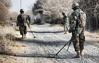 Unexploded ordnance - Clearing of explosives on a road in Afghanistan.