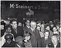 Deputy Mayor Henry Scagnoli, Massachusetts Senator Leverett A. Saltonstall, Mary Collins, Patricia Collins, John Collins Jr., and Mayor John F. Collins in crowd of unidentified people (11072026626).jpg