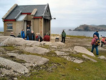 English: Derek Hill's hut on Toraig This hut, formerly a coastguard signal station, was used by the late Derek Hill, an English landscape painter, on his frequent visits to Toraig from 1956. His work provides a record of the islander's life from that time.