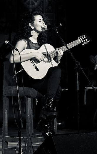 Dina El Wedidi - Dina El Wedidi playing Guitar