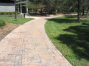 A brick section of the old Dixie Highway East Florida Connector on the west side of Lake Lily in Maitland, Florida. It was built in 1915 or 1916, paved over at some point, and restored in 1999.