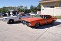 Dodge Charger 1969 RT General Lee Dodge Monaco 1977 Roscoe P Coltrane Dukes LSideFronts TBS 09Feb2014 (14584505594).jpg