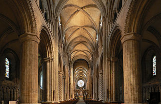Gothic architecture - The transition from Romanesque to Gothic styles is visible at the Durham Cathedral in England, where both pointed and round arches are used in the cathedral's design.