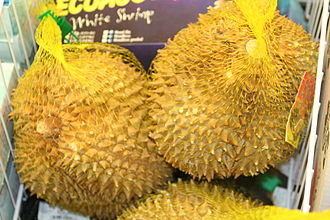 Durian - Durians being sold in mesh bags out of a freezer in a California market