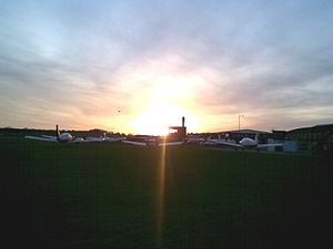 Old Sarum Airfield - View of the apron and tower during sunset