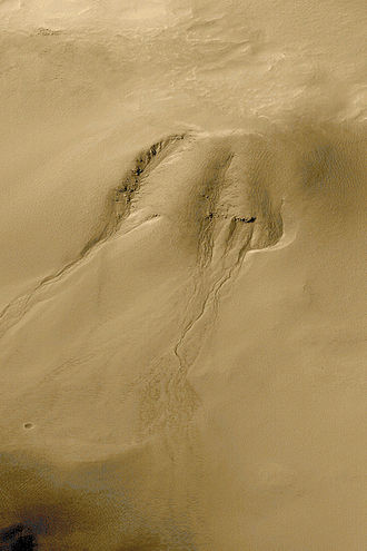 Groundwater sapping - Scientists believe that groundwater sapping created these gullies in Noachis Terra on Mars. NASA image.