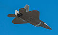 F-22 Raptor showing some vapor behind its nose (7674487652).jpg