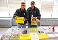 FEMA - 43622 - FEMA Community Relations workers holding up print information in Rhode Island.jpg