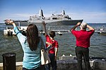 Families wave to their loved ones aboard USS Mesa Verde as the ship departs Naval Station Norfolk. (33107484076).jpg