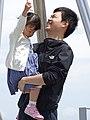 Father with Daughter Ringing Bell - Atop Mount Moiwayama - Sapporo - Hokkaido - Japan - 02 (47977662831).jpg