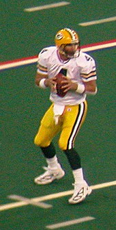 Favre dropping back for a pass during the 2004 season. 270bf7fb5