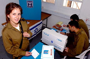 Israeli system of government - IDF soldier at voting booth