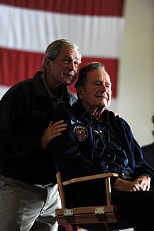 Flickr - Official U.S. Navy Imagery - Former Presidents George H.W. Bush and George W. Bush deliver remarks to the crew during a ceremony aboard the aircraft carrier USS George H.W. Bush..jpg