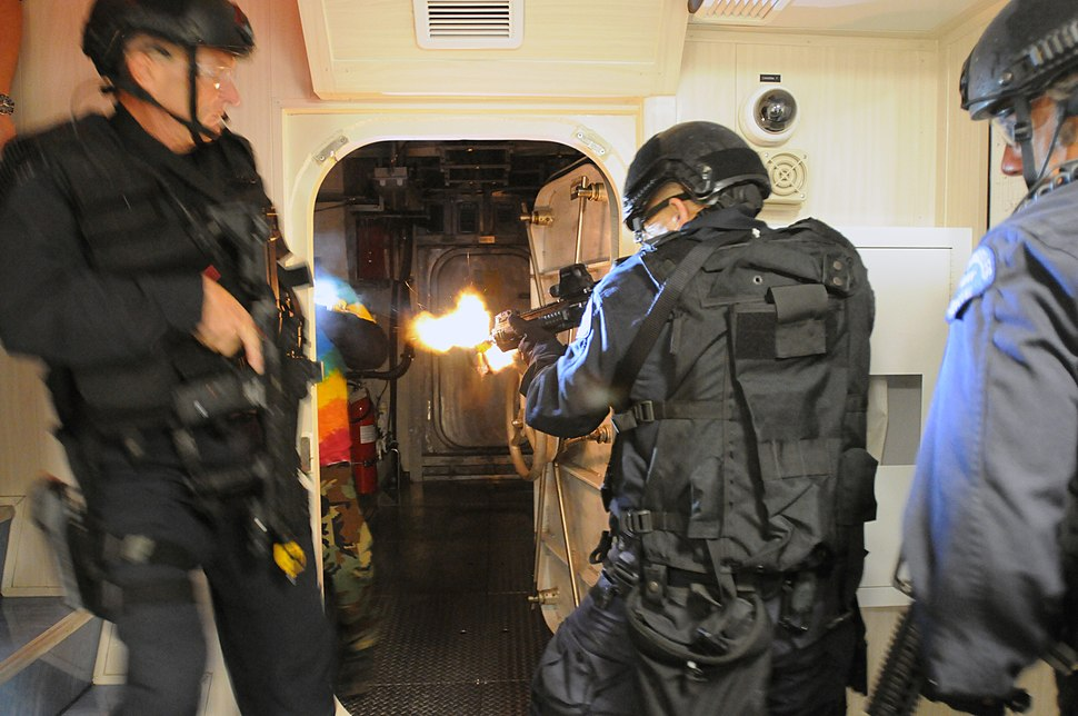 Flickr - Official U.S. Navy Imagery - SWAT team members breach a room and engage hostile targets in a training exercise.