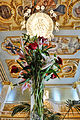 Flowers under the chandelier (3426539726).jpg