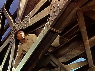 For Whom the Bell Tolls (film) - Robert Jordan (Cooper) rigs the bridge with explosives.