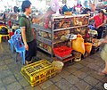 Fowl cages at wet market in Shenzhen, China.jpg