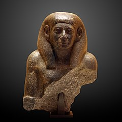 Fragment of statue of a man-E 10445