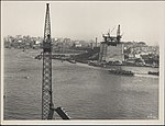 From the northern abutment of Sydney Harbour Bridge, 1928 (8282691885).jpg