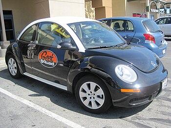 A Best Buy Geek Squad Volkswagen New Beetle.