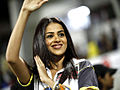 Genelia waving at CCL match, India, 2011.jpg