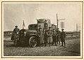 German officers with an armored car (8589740127).jpg