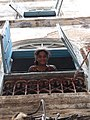 Girl in Window - Stone Town - Zanzibar - Tanzania (8830627594).jpg