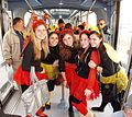 Girls wearing Purim costumes on the Jerusalem Light Rail.jpg