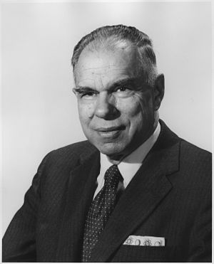 Picture of an elderly man in a suit facing the left to the viewer.