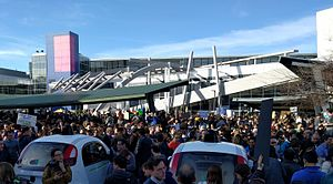 Protests against Executive Order 13769 - Protesters at Google's headquarters in Mountain View, California. Waymo's self-driving cars appear in the foreground.