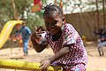 Grace, 5 years old, a Refugee from South Sudan, in a see-saw in Daadab Refugee Camp.jpg