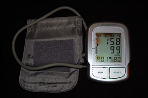 Automated arm blood pressure meter showing arterial hypertension (shown a  systolic blood pressure 158 mmHg, diastolic blood pressure 99 mmHg and  heart rate ...