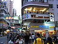 HK Mong Kok Bute Street evening corner building Tong Lau shop 零食物語 Okashiland up-stair barber shop Sept-2012.JPG