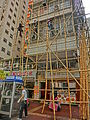 HK Yau Ma Tei Man Ming Lane 文明里 facade Bamboo scaffolding workers at work Feb-2014 Arthur Street.JPG