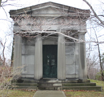 A mock Greco-Roman style mausoleum, about the size of a small house