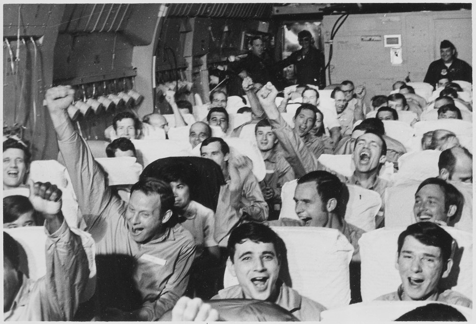 Hanoi, North Vietnam....American servicemen, former prisoners of war, are cheering as their aircraft takes off from... - NARA - 532510