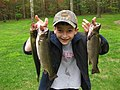 Happy boy with the trout he caught (5727916414).jpg