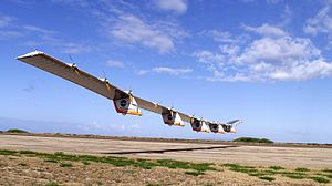 Helios Prototype - Helios Prototype flying wing moments after takeoff, beginning its first test flight on solar power from the U.S. Navy's Pacific Missile Range Facility on Kauai, Hawaii, July 14, 2001.
