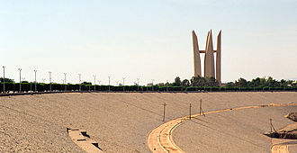 Aswan Dam - A view from the vantage point in the middle of High Dam towards the monument of Arab-Soviet Friendship (Lotus Flower) by architects Piotr Pavlov, Juri Omeltchenko and sculptor Nikolay Vechkanov