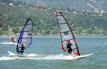 Windsurfing and kitesurfing on a fine summer d...
